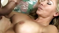Blonde mature gives handjob before fuck