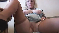 Amateur matures stripping on a bed