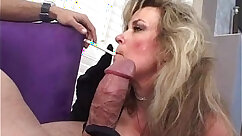 blond mature smokes in her car in a park