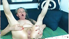 Bootylicious granny masturbates with a pink dildo